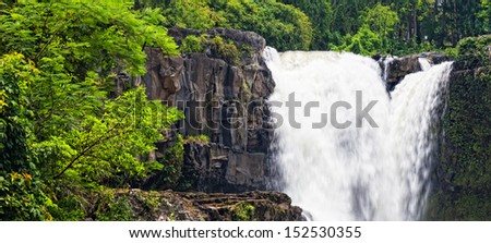Tegenungan Waterfall is a beautiful waterfall located in plateau area and it is one of places of interest of Bali - stock photo