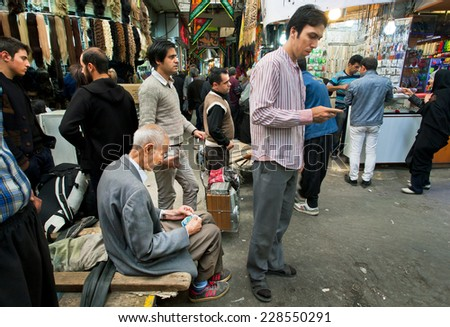 TEHRAN, IRAN - OCTOBER 6: Crowd young and elderly people earn and spend money in the bazaar on October 6 2014.  - stock photo