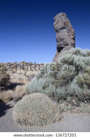 Teide National Park, Tenerife, Canary Islands, Spain. Roques de Garcia. Ancient stones and the stiffened volcanic lava. Fantastic landscapes at the volcano bottom to Teide. - stock photo