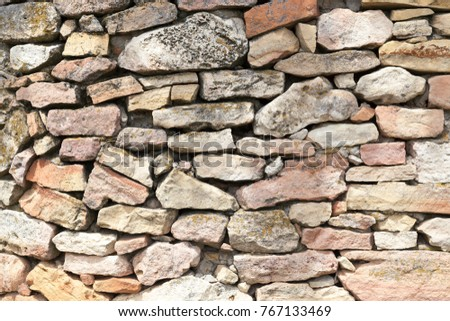 Teksturna of a stone wall close up