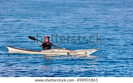 Tel Aviv - April 29, 2016: Man kayaking doing a sportive competition in Tel Aviv