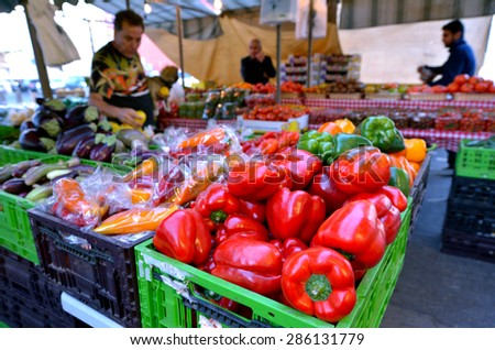 TEL AVIV, ISR - MAR 27 2015:Fresh vegetables for sale in Shuk HaNamal Market in Tel Aviv port Israel.It's a food and produce market and the only fully covered of all Tel Avivs marketplaces. - stock photo