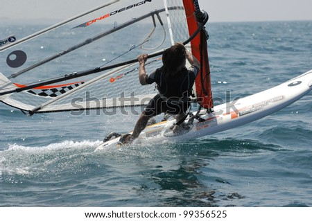 TEL-AVIV, ISRAEL-APRIL 4: Participants compete in the  Israel Youth Championship of Yacht & Windsurfing 2012 on April 2-4, 2012 in Tel-Aviv, Israel - stock photo