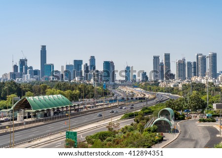 TEL AVIV, ISRAEL - APRIL 20, 2016 : Scenery of Tel Aviv University train station and Ayalon highway over Ramat Gun skyscrapers in Tel Aviv, Israel.  - stock photo
