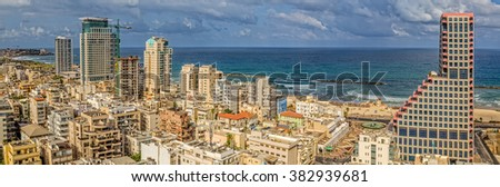 TEL AVIV, ISRAEL - JUNE 19, 2015: Aerial view of the city buildings, beach, riviera and hotels. - stock photo