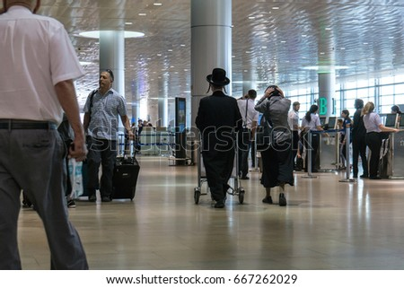 Tel aviv, Israel- June 14, 2017 : Jewish orthodox family arriving for check in to fligh in Ben Gurion Airport
