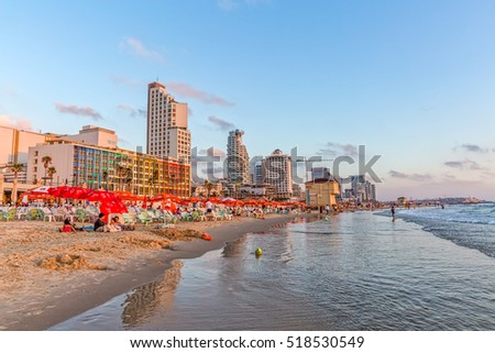 TEL AVIV, ISRAEL - JUNE 19, 2015: Panorama of the beach, riviera, hotels and long promenade along skyline shot from the marine.