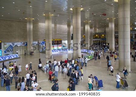 Tel Aviv,Israel - JUNE 5: Passengers in the Ben Gurion Airport Arrival Hall on June 5, 2014  in Tel Aviv,Israel.  Ben Gurion is an Entrance to Jerusalem for Christians pilgrims from all the world - stock photo