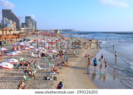 TEL AVIV, ISRAEL - JUNE 19, 2015 : Tel-Aviv beach and people enjoying the evening on the eve of the day off (Mediterranean sea. Israel) - stock photo