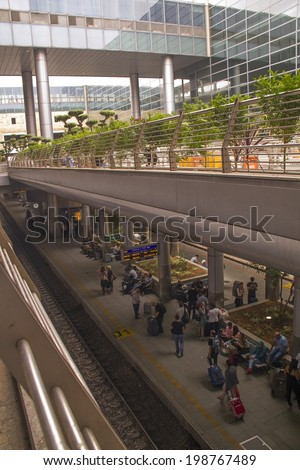 TEL AVIV, ISRAEL JUNE 5: Travelers wait for train from Airport on June 5, 2014 in Tel Aviv. The contemporary railway station runs north and south of Israel. It opened in 2004. - stock photo