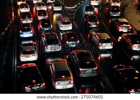 TEL AVIV, ISRAEL -  MARCH 13, 2014: Cars stand in a traffic jam in the evening - stock photo