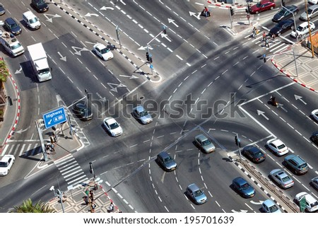 TEL-AVIV, ISRAEL - MAY 22 : Overhead view of urban intersection with exit to highway - stock photo