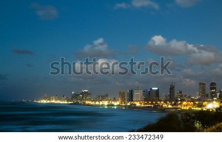 Tel-Aviv , Israel - November 22 . 2014 : Tel Aviv. Night view from Jaffa. View of the hotel on the beach . - stock photo
