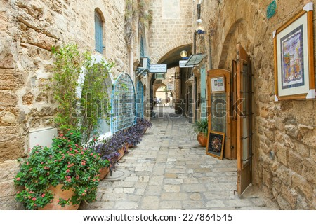 Tel Aviv, ISRAEL - November 2, 2014 : Typical view of Jaffa's narrow old alley. Jaffa is part of Tel Aviv, Located to the south and known as an ancient port city that goes back to the bronze age.
