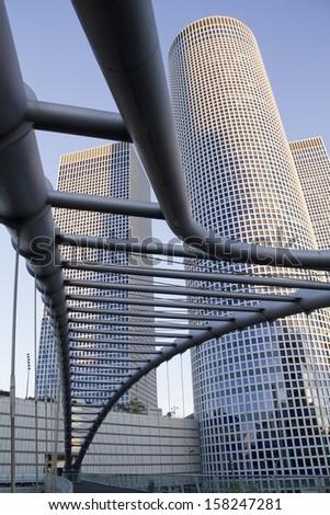 TEL-AVIV, ISRAEL - September 06 : Modern Buildings (Azriely Mall) with sky-walk bridge September 06, 2013 in Tel-Aviv, Israel. - stock photo