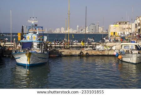 TEL AVIV, JAFFA -  October 26, 2013: The old port with fishing ships in Jaffa. Tel Aviv. Israel on October 26, 2013  - stock photo