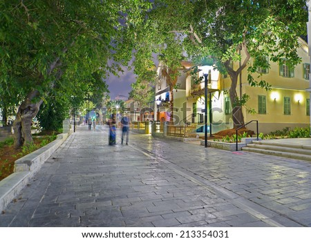 Tel Aviv Night Life - Restored houses at night at the hip Sarona district featuring rich night life and conserved Templer era German architecture from the late 1800's - stock photo