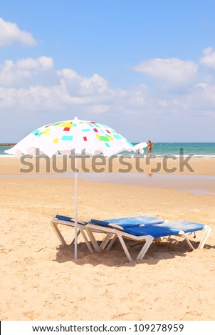 Tel-Aviv sandy beach colorful umbrella (Mediterranean sea. Israel) - stock photo