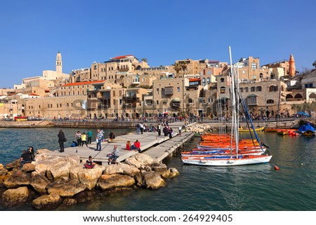 TEL AVIV - YAFO, ISRAEL - MARCH 17, 2015 : Panoramic view of Old Yafo and ancient port mooring. Ancient Yafo is popular tourist site for citezens and visitors of Israel - stock photo