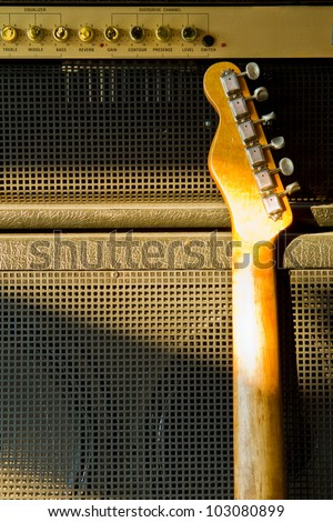 Telecaster guitar model and combo amplifier - stock photo
