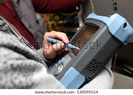 Telecom Technician Holding Reflectometer Fibre Optic Stock Photo ...