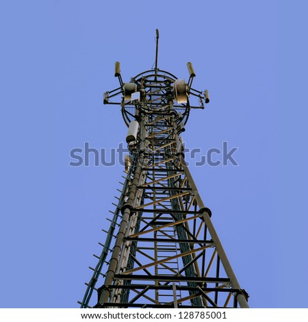 telecom tower; telecommunications/cellphone mast against clear blue sky; good copy space - stock photo