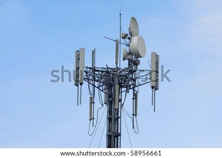 telecom transmitter on blue sky - stock photo