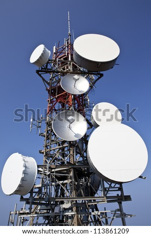 Telecommunication and satellite tower - stock photo