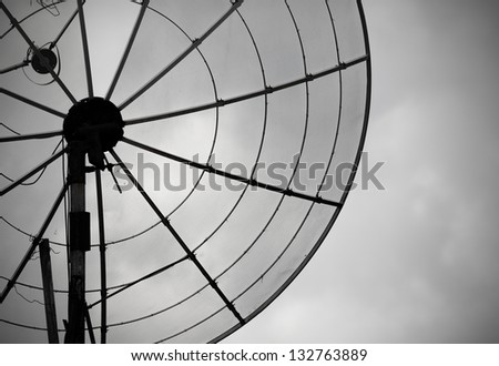 Telecommunication concept. Old satellite antenna - bad communication - stock photo