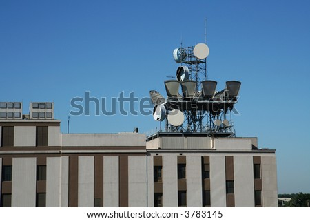 Telecommunication Equipment on a Rooftop - stock photo