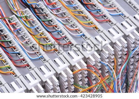 Telecommunication main distribution frame with cables, closeup - stock photo