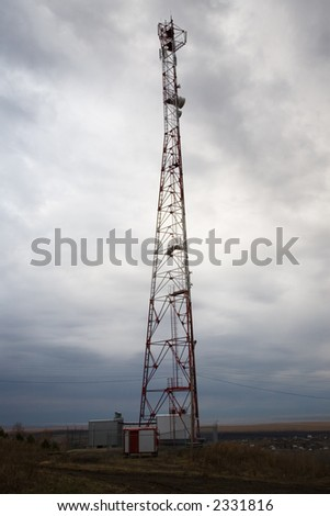 Telecommunication mast and cloudy sky. Near helth-resort Belokurikha.