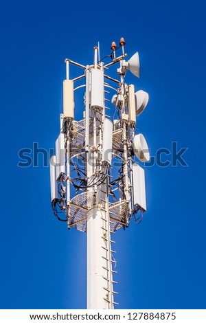 Telecommunication mast at the blue sky - stock photo