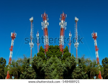 Telecommunication mast television antennas on blue sky