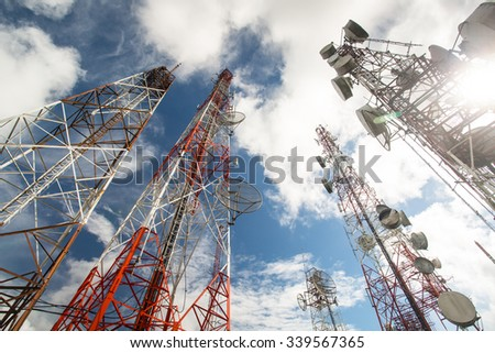 Telecommunication mast TV antennas wireless technology with blue sky in the morning - stock photo