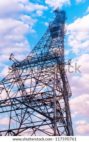 Telecommunication mast with blue sky background