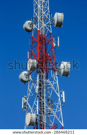 Telecommunication mast with microwave link and TV transmitter antennas.