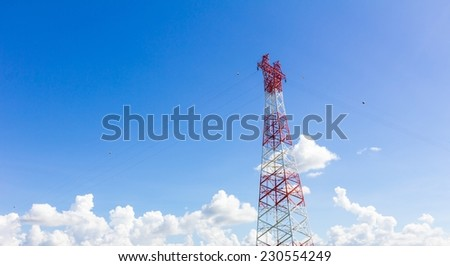 Telecommunication mast with microwave link and TV transmitter antennas on blue sky - stock photo