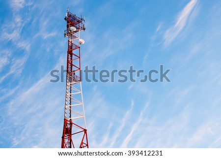 telecommunication tower against a beautiful sky. Cellular antenna on the tower. the beauty of nature and high technology. copy space for your text - stock photo