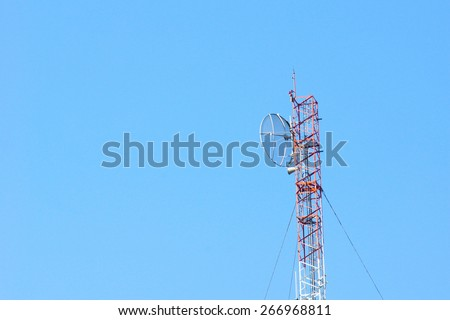Telecommunication tower against blue sky - stock photo