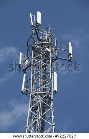 Telecommunication tower against the blue sky