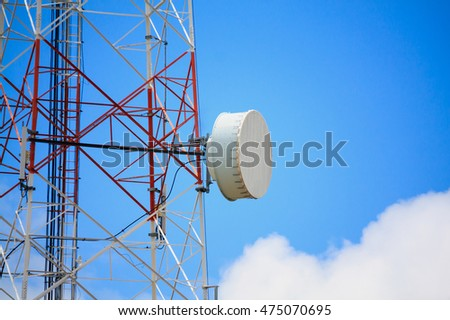 Telecommunication tower and satellite antennas wireless technology on blue sky