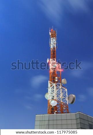 telecommunication tower at night - stock photo