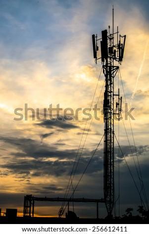 Telecommunication Tower in Evening Light. Telecom antennas. - stock photo