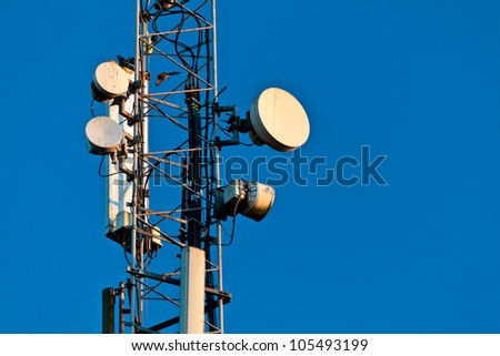 Telecommunication tower in the evening - stock photo