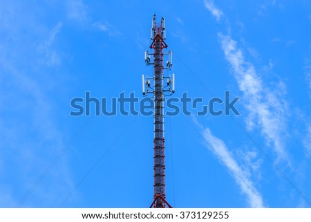 telecommunication tower in the middle of the picture with blue sky, - stock photo