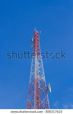 Telecommunication tower on blue sky blank background. Used to transmit television and telephone signal - stock photo