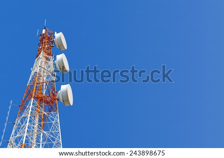 Telecommunication tower on blue sky blank background. Used to transmit television and telephony signal - stock photo