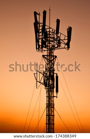 telecommunication tower - silhouette antenna broadcasting network frequency transmitter communication satellite - stock photo