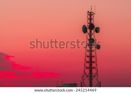 Telecommunication tower structure with sunset sky background - stock photo